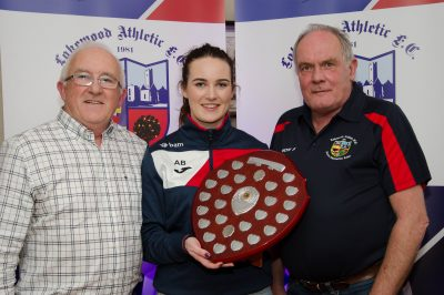 Ger Cahill and Joe Dillion present  the Eithne Hammond Club Person of the Year award to Ali Brady for her contribution to the Academy coaching and captaincy of the Senior Womens team